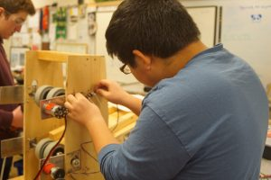 electrical subteam member working on a motor