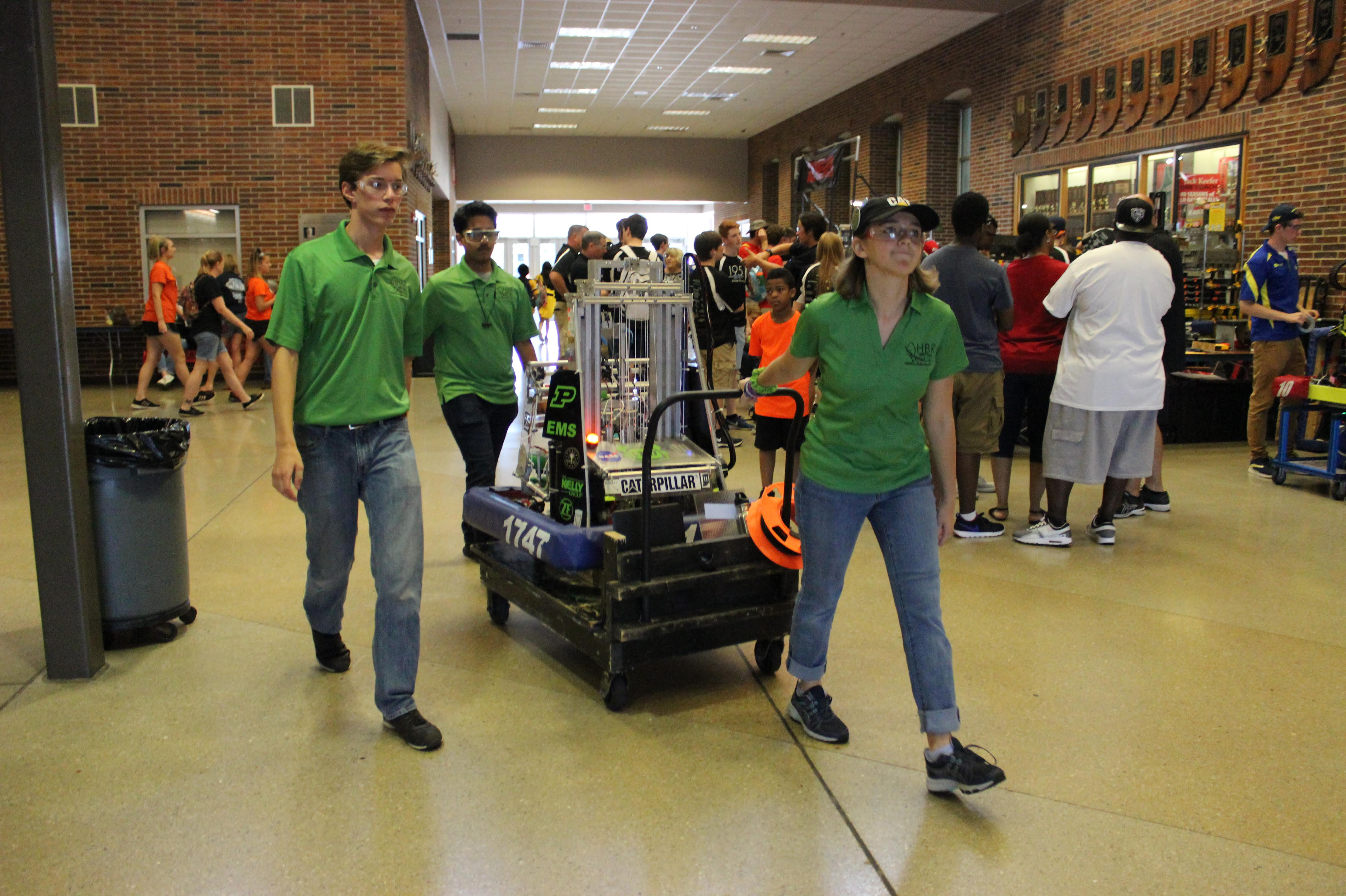 Drive team pulling a cart with our robot